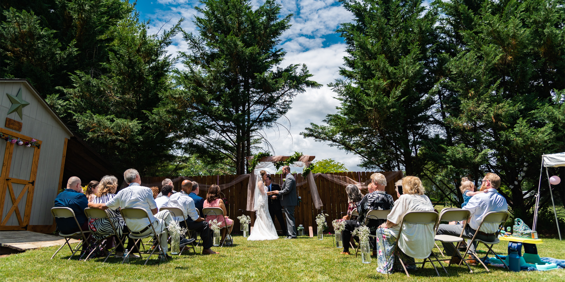 A couple stands at the altar during their small backyard wedding in Hagerstown, Maryland