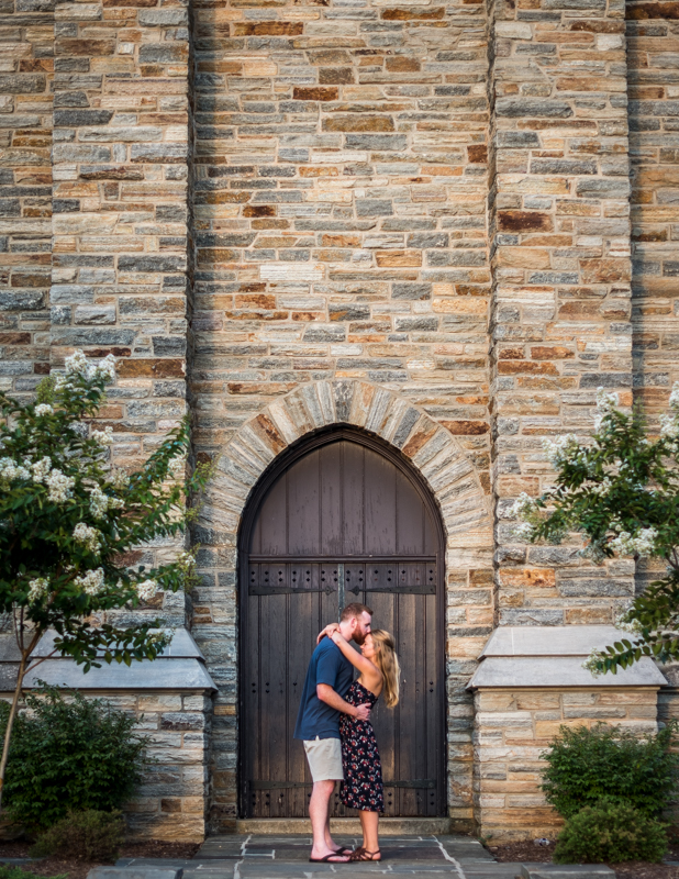 A couple is framed by the door of the bell tower at Baker Park in Frederick, Maryland