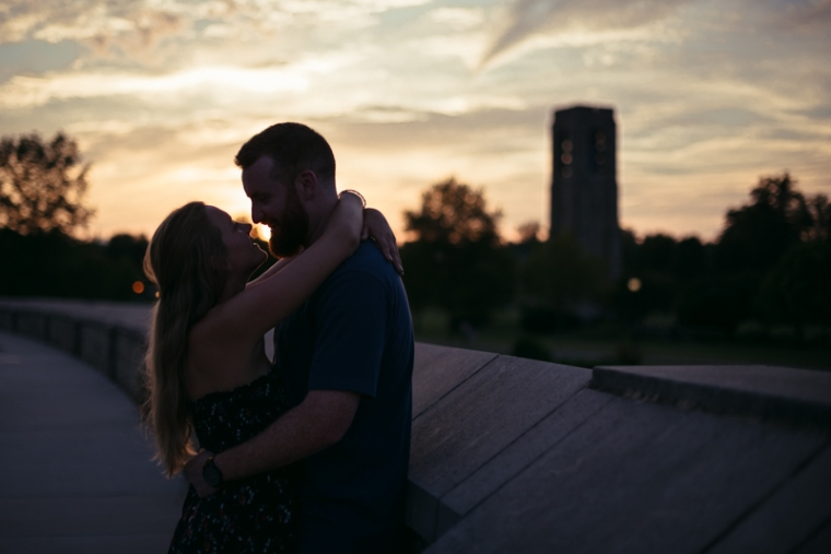 A couple looks at each other during sunset at Baker Park in Frederick, Maryland
