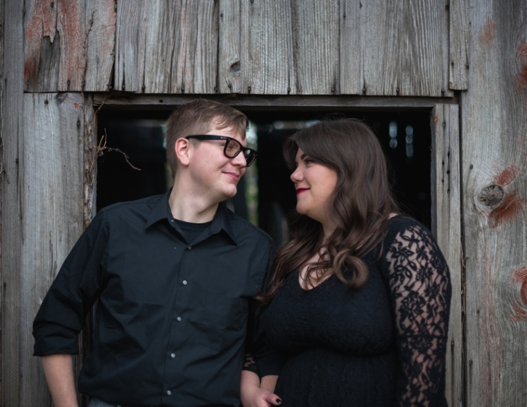 A couple smiles at each other during their engagement photoshoot in Harpers Ferry, West Virginia
