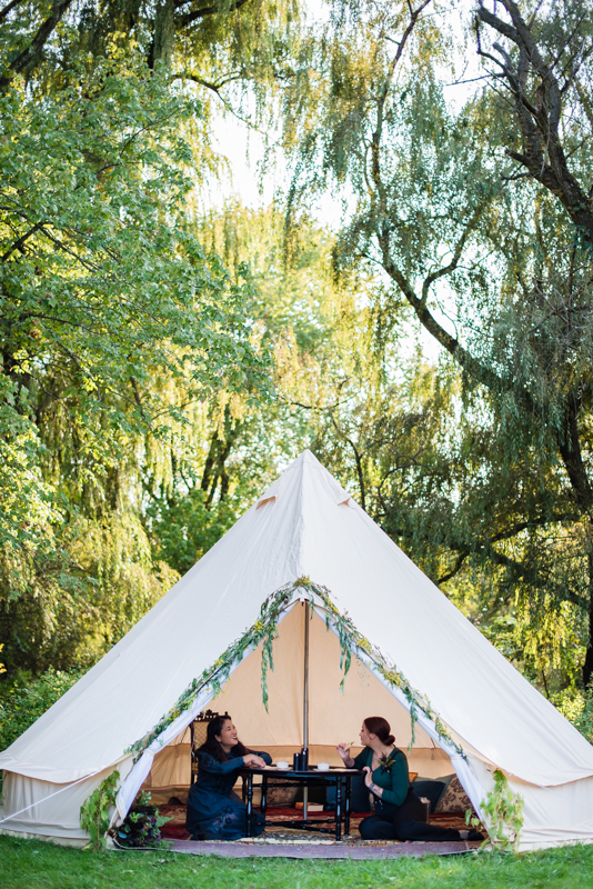 Two brides enjoy a snack for a brief rest during their offbeat wedding in northern virginia