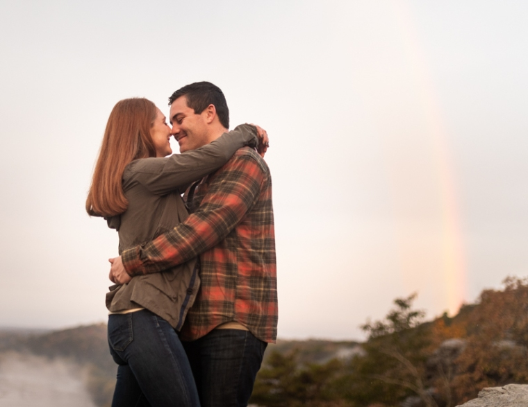 Couple poses together during an engagement shoot at Maryland Heights Overlook