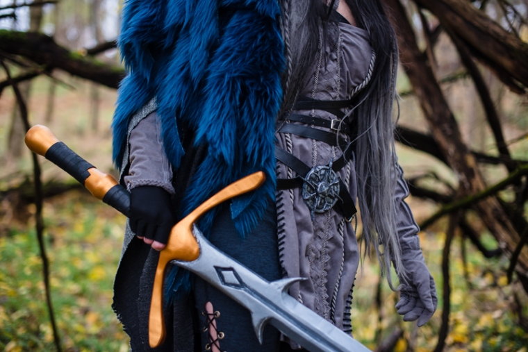 Close up details of a woman's sword from her Yasha Cosplay from Critical Role