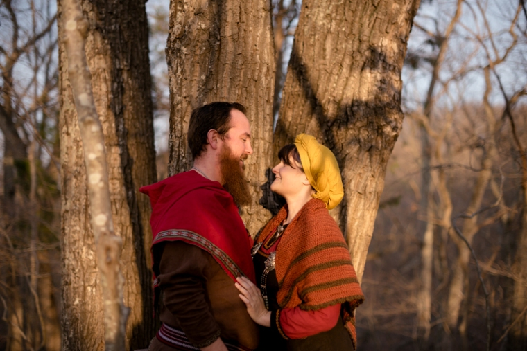 A couple in larp costume laugh together during their viking engagement photoshoot in Harpers Ferry
