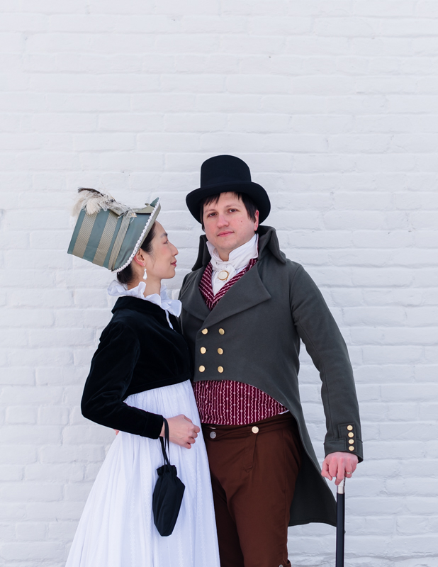 A woman in historical costume smiles up at her husband at Rose Hill Manor Park in Frederick Maryland