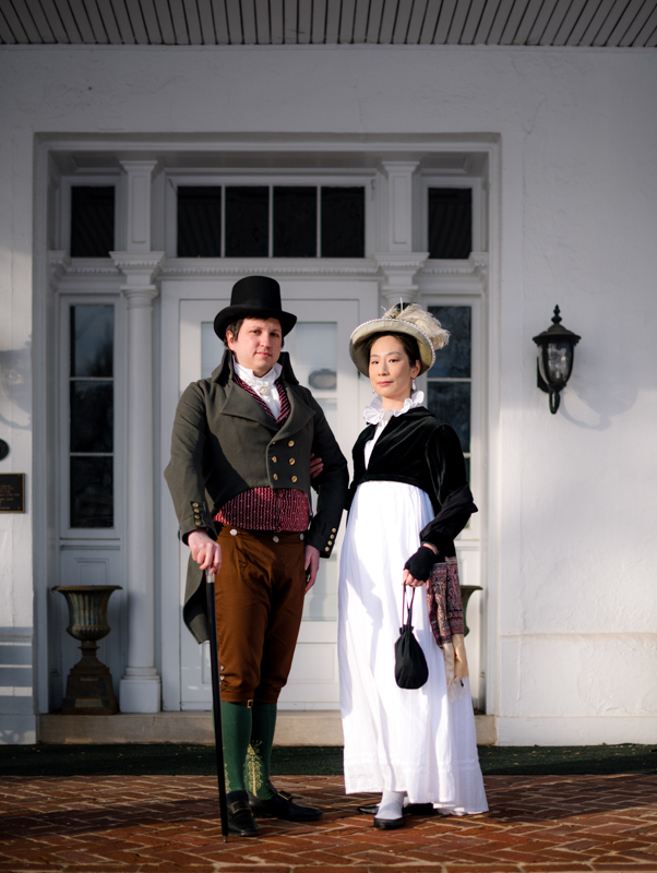 A historical costuming couple stand in front of Rose Hill Manor in Frederick, Maryland