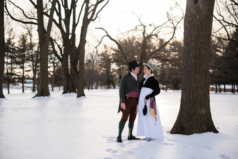 A historical costuming couple poses together on a snowy afternoon at Rose Hill Manor Park in Frederick, Maryland