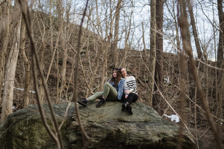 A couple looks out over a cliff during their Harpers Ferry engagement shoot