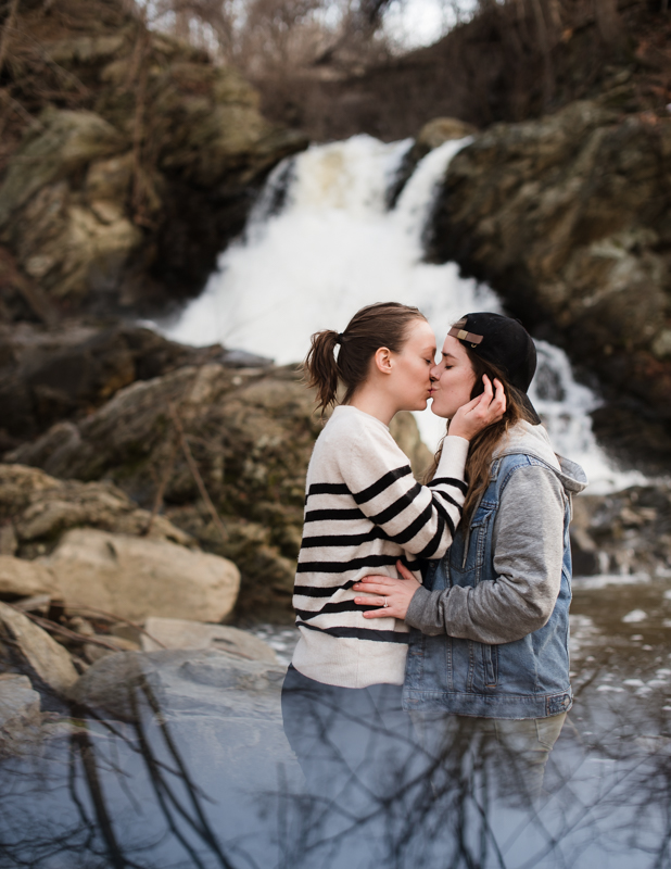 A same-sex couple kisses at the base of a waterfall in Harpers Ferry, West Virginia