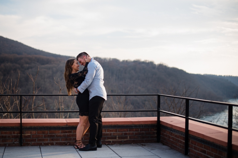 A couple stand at an overlook in Harpers Ferry during their engagement photos
