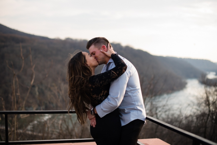 A man gives his fiancee a kiss during their Harpers Ferry engagement photos