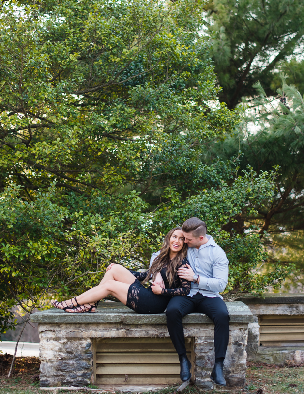 A couple cuddle together during their Harpers Ferry engagement photos