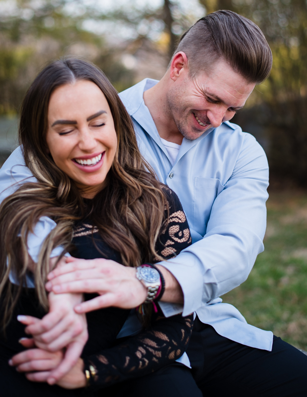 A woman laughs with her fiancee during their Harpers Ferry engagement photos