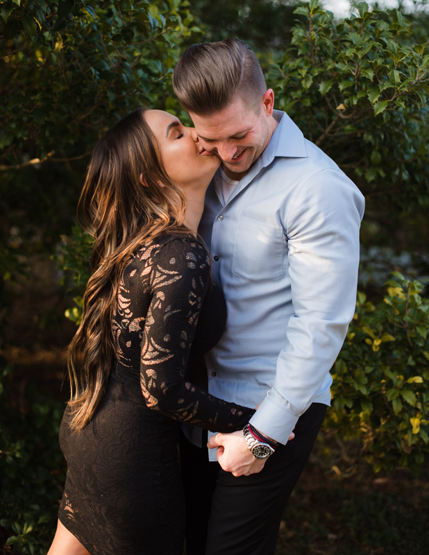 A woman gives her fiancee a kiss on the cheek during their Harpers Ferry engagement photos