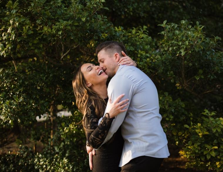 A man gives his fiancee a kiss on the cheek during their Harpers Ferry engagement photos